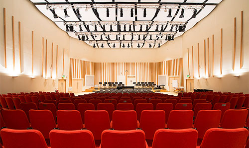 Red seats in the Martin Harris Centre's Cosmo Rodewald concert hall
