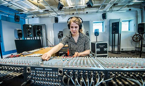 Female student at a mixing desk